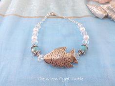 Tibetan Fish Bracelet by TheGreenEyedTurtle on Etsy, $8.00
