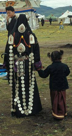 Mother and Daughter in Litang Horse Festival... Litang, Kham, Tibet.  Khampa Festival.  China