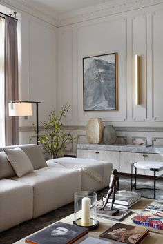 """""""In this Knightsbridge penthouse apartment, we used a light and neutral palette in the living area, mixing earthy tones with metallics to soften and warm,"""""""