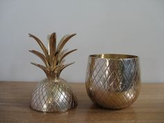Vintage large brass pineapple ice bucket, trinket box, candleholder, 9.5 inches tall, Hollywood regency, retro, mid century. $78.00, via Etsy.