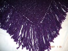 Purple shawl knitted from homespun.