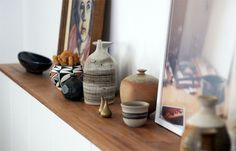 eclectic pottery / mini bronze vases / art - painting and print #styling #shelving