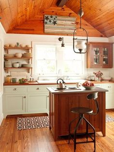 a very cozy kitchen indeed. Open shelving, peaked roof