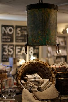 light fixture made from an old bucket.  great patina!  a neat way to re-purpose a family treasure.