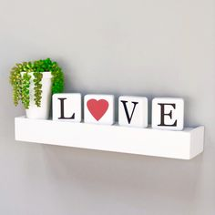 """Metal decor with the messaged """"Love"""" in black color. Each metal block have this measures accessor Other Accessories, Floating Shelves, Wall Decor, Love, Metal, Decor Ideas, Sweet, Home Decor, Ideas"""