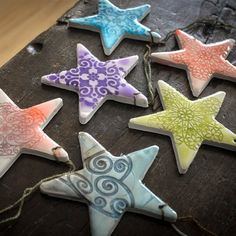 These easy polymer clay ornaments imitate the look of glazed pottery, and make great tree decorations, gift tags, or even pendants.