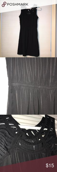 American Eagle dress This black dress is former fitting, with a fun design around the neck. Good condition, small deodorant stains but you can barely see them in person American Eagle Outfitters Dresses