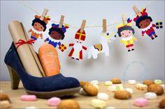 Sinterklaas slinger gemaakt van papier met behulp van de gratis printable die je vind op het blog van NobodyELSe via Freubelweb.
