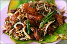 Char Koay Kak - Is a popular Penang hawker food. It is rice cakes fried in thick black soy sauce, with eggs, bean sprouts and chye por (preserved vegetable bits). The bean sprouts and chye por adds crunchiness to the rice cakes. Chilli paste gives it spiciness. Some times seafood such as prawns and squid rings are added.