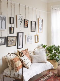 This rail with twine is another option, and less damaging to your walls. The pieces are easier to move around. / 5 Steps to the Perfect Gallery Wall