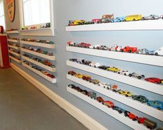 Book ledges repurposed as toy car storage for kids