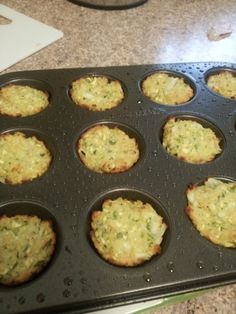 15cal Zuccini Tots  Ingredients:   Squash - Zucchini, includes skin, raw, 1 cup, chopped   Onions - Raw, 1/4 cup, chopped   Parm. Cheese Grated - 1/4 cup   Panko Bread Crumbs- 1/4 cup   Eggs - Whole, raw, 1 large   I put the onion and zucchini in the food processor so it's finely chopped. Mix everything together. Spoon by the teaspoonful into mini muffin tin (GREASED) Pat down with back of spoon. 400 degree oven for 20 minutes or until a brown crust on the edges. Makes 12 tots per tin.