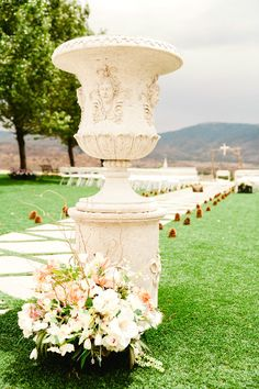 statue wedding pine cones flowers country view