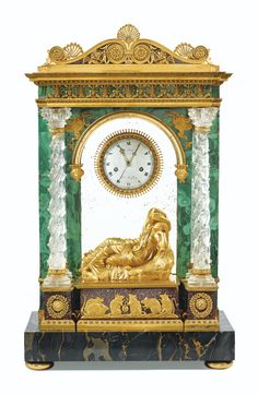 A GILT-BRONZE ROCK CRYSTAL AND MALACHITE MANTEL CLOCK, LATE LOUIS XVI, THE DIAL AND THE MOVEMENT SIGNED LE PAUTE / HGER DU ROY