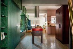 Point Supreme Architects reworked the floor plan to create a single, open-plan space that combines the living, dining and kitchen areas. Athens Apartment, Family Apartment, Apartment Interior, Bedroom Apartment, Stone Flooring, Wooden Flooring, Green Plywood, Plywood Storage, Glass Brick