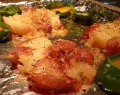 Oven Roasted Smashed Potatoes Recipe  I added rosemary and garlic to the oil on top. Delicious!