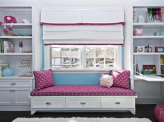 Beautiful window seat! Love the pink and blue!