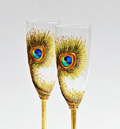 Peacock Feathers Wedding Toasting Champagne Flutes Hand Painted,set of 2 Gold,Blue,Purple,Green. $49.80 USD, via Etsy.