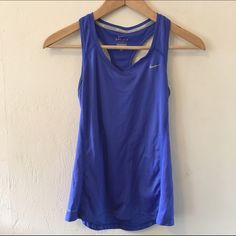 Periwinkle Nike Dri Fit Running Tank XS Such a pretty color, such a functional top. Worn and shows some wear under arms (see photo 2) but the darkening is subtle. No trades no PayPal Nike Tops Tank Tops