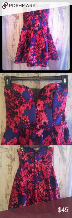 Strapless Floral Homecoming/Prom Dress Vibrant strapless floral dress from B. Darlin.  Sweetheart neckline with mesh inset. A-line Silhouette and pleated throughout. Hidden back zipper closure. Lined. Hits above the knee. Worn one time. Wonderful condition. Large (10/12) B. Darlin Dresses Strapless