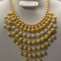 New Wooden Beaded Bib Style Necklace in Two Tone Yellow With No Tags    Type: New Necklace  Color: Two Tone Yellow/ Materials: wooden beads  Size: Necklace Approximately 18 inches   Condition: New Never Worn/ US Delivery Only  Free/ No International Shipping Nickel and Lead Compliant