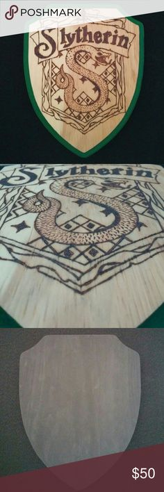 Harry Potter Slytherin crest wood burned plaque This is a wood burned Slytherin house crest plaque prefect for hanging on your wall. The boarder and back are painted green and black respectively. I recommend using velcro command strips to hang.  Dimensions: 9 x 12 inches This item is handmade by me. Check out my closet for more items like this! Bundle and save! Harry Potter Accessories
