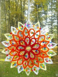 Another colourway for that beautiful beaded plastic canvas suncatcher - I think I prefer this one. Plastic Canvas Coasters, Plastic Canvas Ornaments, Plastic Canvas Crafts, Plastic Canvas Patterns, Beaded Christmas Ornaments, Christmas Crafts, Christmas Puzzle, Quilling, Diy Xmas Gifts