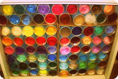 tissue paper...I am in the process of organizing my craft closet...will do these with papertowel holders and put in a cute storage crate!