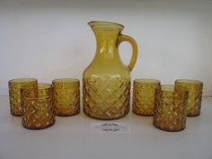 SOLD BY NBV - More vintage finds added daily. Complete set of amber glass water pitcher & 6 glasses $45. Great retro set in heavy, thick glass. Good condition with no chips or cracks. Pitcher measures 23.5 cm high, glasses measure 8.8 cm high.