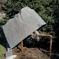 Hide your irrigation equipment with this oblong, landscaping-friendly faux rock.