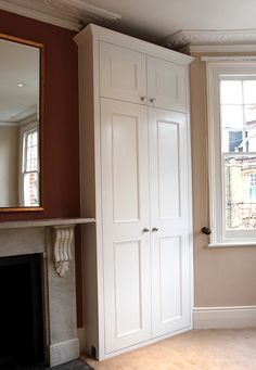 A pair of traditional fitted wardrobes with shaker beaded doors and cornice along the top, made few inches below the ceiling level to keep original details on the ceiling. Fitted and hand painted by JVcarpentry team in Putney SW15, near Fulham and Wandsworth on February 2013