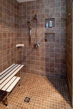 Like this shower, minus the seats and with a shower head on both walls!