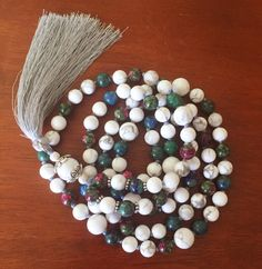 A personal favorite from my Etsy shop https://www.etsy.com/listing/265177917/108-bead-knotted-yoga-mala-white
