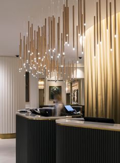 Nulty - Hard Rock Hotel & Cafe, London - Maple Drumstick Light Feature Above Reception Desk Sparkling Fibre Optics Hotel Reception Desk, Reception Desk Design, Curved Reception Desk, Lobby Reception, Boutique Interior, Lobby Interior, Modern Hotel Lobby, Hotel Lobby Design, Luxury Lighting