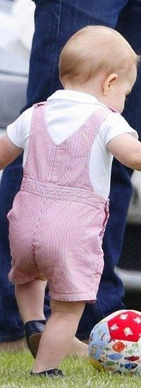 Prince George cheers on his father, Prince William during Father's Day Polo Match in Gloucestershire, June 15, 2014.