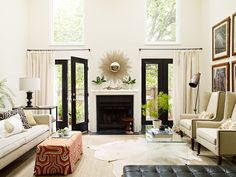 paint color for bathroom -- like it with white trim and black accents The walls in this room are seashell by Benjamin Moore and the curtain panels are custom and made of oyster-colored linen.
