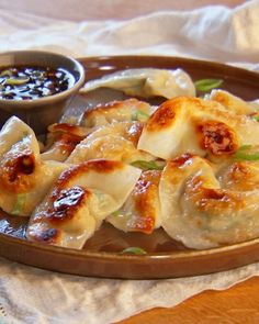 Pot Sticker Dumplings and Soy-Vinegar Sauce - Dumpling wrappers -- Chinese wonton or Japanese gyoza skins are the same thing -- are now widely available in the frozen-food section of most markets.
