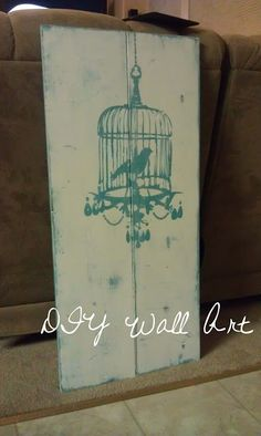 Near Normalcy: DIY Wall Art Tutorial you don't have to paint a canvas at all. A couple of wood boards are the perfect backdrop for a stenciled birdcage by Near Normalcy.