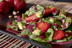 """Strawberry, Avocado and Greens with Ruby Dressing The berry dressing is so colorful and brings tender greens together with fresh strawberries and creamy avocado for a delicious combination, fit for any """"posh"""" spa menu or your kitchen table! For the Ruby Dressing 1/2 cup fresh strawberries, washed, stemmed 1/2 cup fresh or frozen raspberries, rinsedRead More »"""