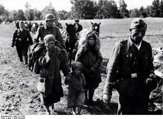 14th Waffen Grenadier Division of the SS Galicia (1st Ukrainian) somewhere in Russia, with women and a child 1943
