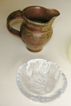 Jug marked BB; small glass bowl with leaf design