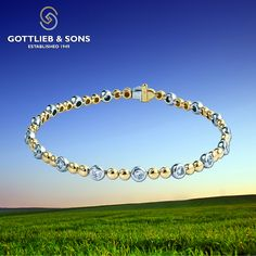 This beautiful bracelet will complement any style. This two tone 14K Yellow and White Gold #bracelet features alternating round #diamonds and round yellow gold balls for a truly unique look. Visit your local #GottliebandSons retailer and ask for style number 29470B. http://www.gottlieb-sons.com/product/detail/29470B