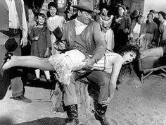 "John Wayne spanking Maureen O'Hara in ""McLintock"""
