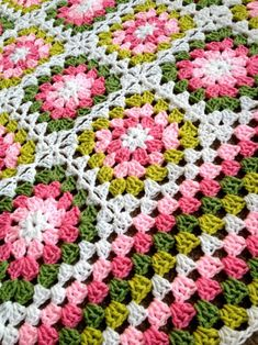 "BabyLove Brand says the following about this lovely little granny blanket: ""My first Flower Garden Blanket – Lovely pinks and greens. I made this blanket – for the most part – in my car in the car-rider line, picking up my eldest from school. I used..."