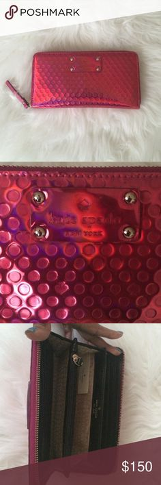 Metallic Red/Pink Kate Spade Long Wallet Limited edition Kate Spade wallet. Color is a metallic pink/red blend. Wallet has 12 card holder slots, 2 large slots for cash or additional cards, and a large zipper compartment for change. Also has one large pocket on back of wallet. In excellent condition, no stains or tears. A few scratches on the outer Kate Spade emblem from normal usage. kate spade Bags Wallets