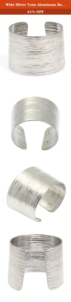 Wide Silver Tone Aluminum Bark Cuff Bracelet By John S Brana Handmade Jewelry Hypoallergenic (7.5 Inches). The John S Brana Aluminum Bark Cuff is metal reimagined. As you study the intricate ridges in its sleek surface, you can almost see the aluminum being transformed into the bark of a living tree before your eyes. The ridges of the metal bring texture to outfits, so the bracelet is perfect for adding interest to any ensemble. Pair it with a floral blouse and a pencil skirt for a…