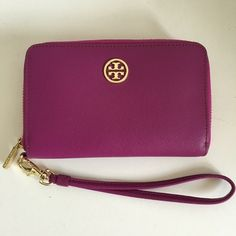 "Tory Burch Robinson Smart Phone Wallet Tory Burch Robinson Smart Phone Wallet in royal fuchsia/gooseberry. Saffiano leather with gold hardware. Removable wrist strap. Zip around closure. Inside has one zip pocket, 3 credit card slots.  Approximately 6""x3.5""x1"". Tory Burch Bags Wallets"