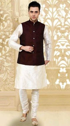 Imposing Off White Kurta With Cotton Flex Jacket Nehru Waist Coat DTKPJ5150  Classy off white art dupion and cotton flex jacket nehru waist coat style kurta payjama which is stunningly made with fancy button work. Stole and mojari can be purchased additionally. They are not a part of this sherwani. Any biggest size possible. Extra charges will be charged for size 44 to 50