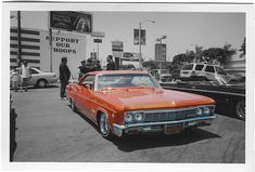 """Members of Lifestyle Car Club meet at a gas station parking lot in East LA. In the foreground, """"Apocalypse Now,"""" a 1965 Chevrolet Impala. Los Angeles, California, 2005. Photography © Martin Hoyem."""