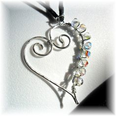 heart pendant..might be cute with  kids birthstones